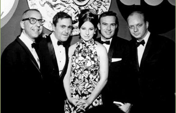 Presenter Barbra Streisand poses backstage with the winners of the 1967 Tony Award for best musical, Cabaret: (from left) librettist Joe Masteroff, composer John Kander, lyricist Fred Ebb, and producer Harold Prince. Photo by: ABC, Inc